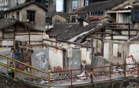 Demolishing houses to build new roads. This is Shanghai.